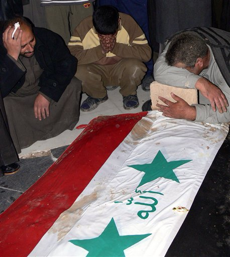 iraqi-flag-saddam-funeral-no-writing.jpg